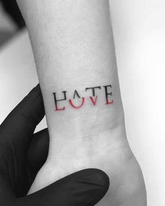 Small Text tattoo on men wrist