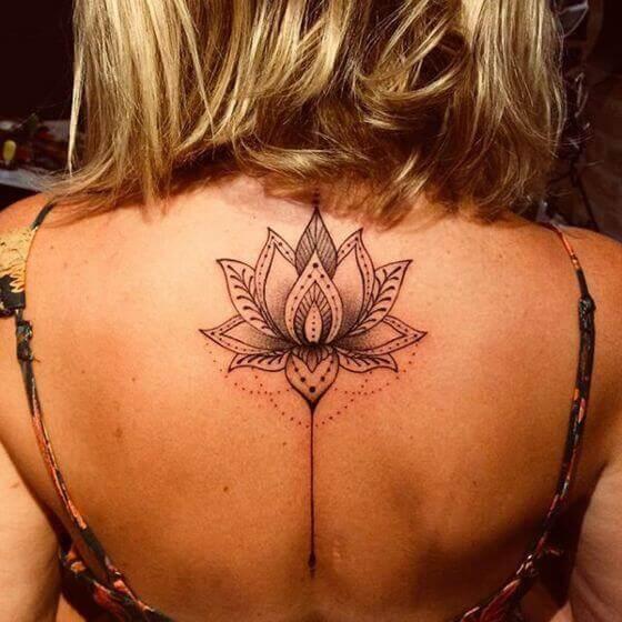 cute lotus flower tattoo on female back