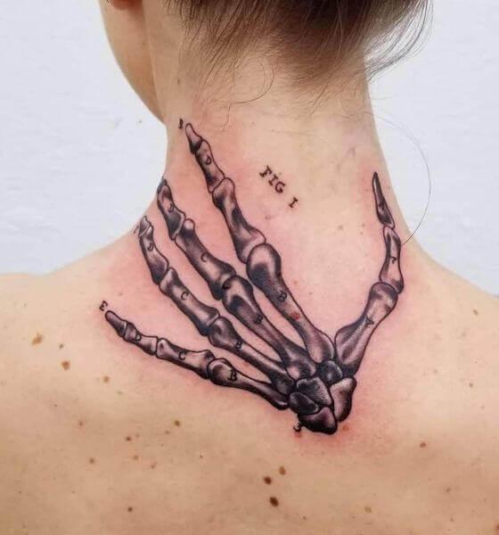 Back Skeleton Hand Tattoo
