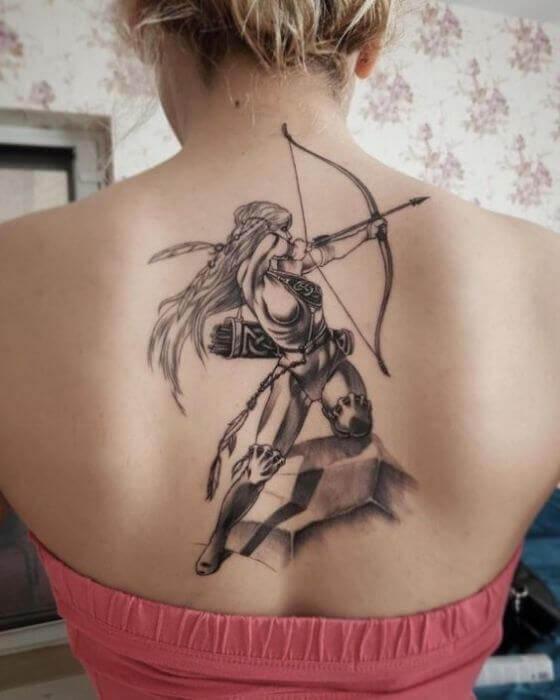 Sagittarius Arrow Tattoo on women Back