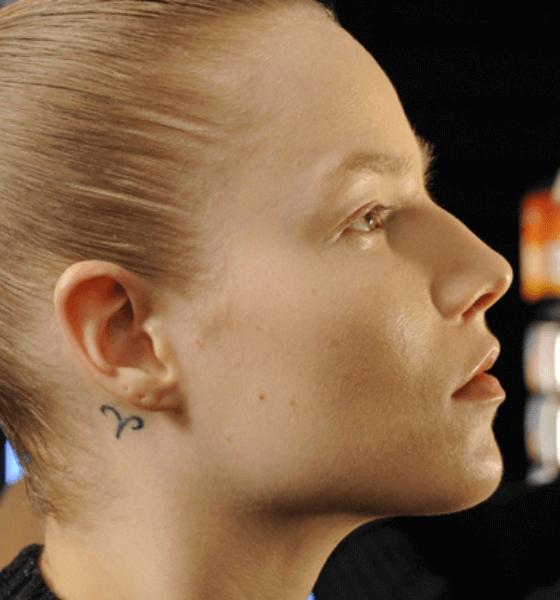 Behind the ear Zodiac Sign tattoo