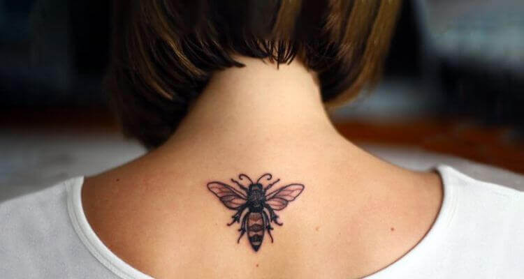 Honey bee tattoo on back