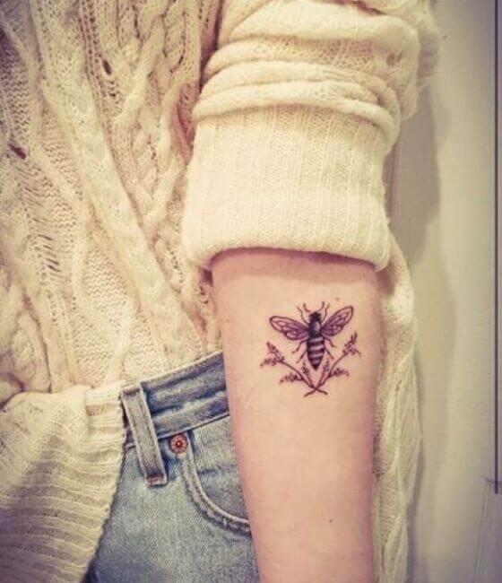 Honey bee tattoo on the girl's forearm