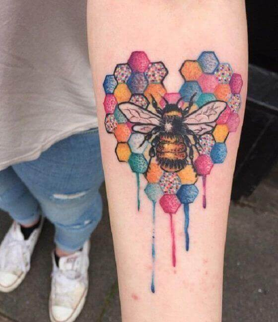 Colorful Honey bee tattoo on the men forearm