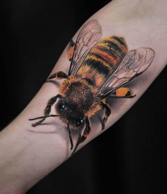 Big Honey bee tattoo on the forearm