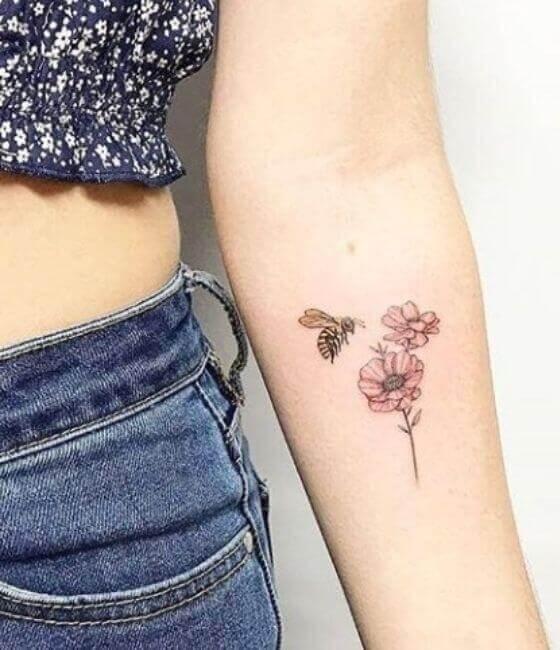 Honey bee tattoo on the women forearm