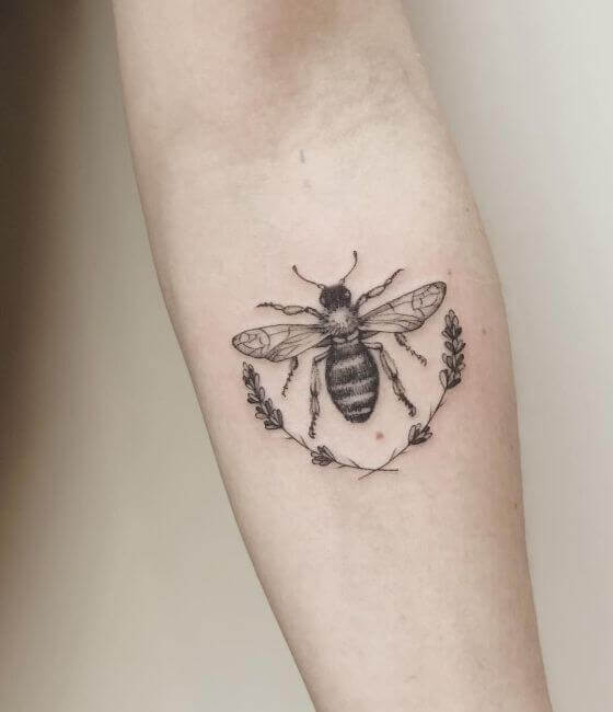 Amazing Honey bee tattoo on the forearm