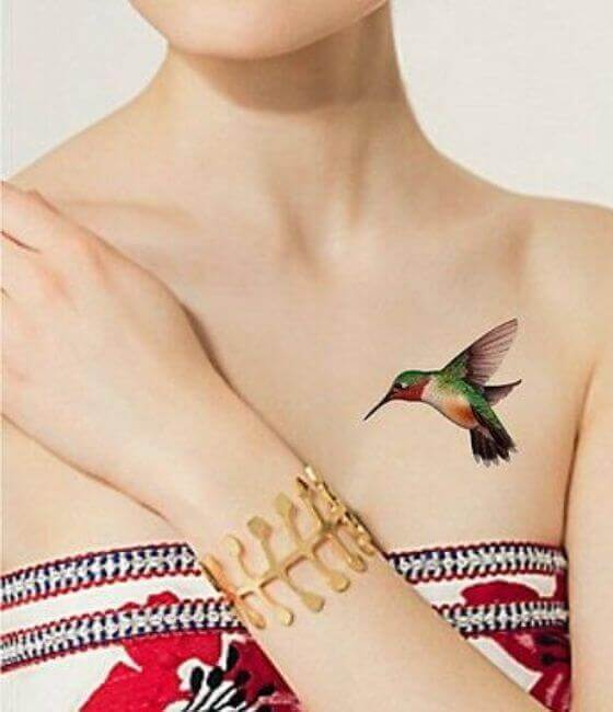 Colorfull small Hummingbird Tattoo On Women Chest