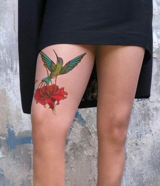 Hummingbird Tattoo with flower On girl Thigh