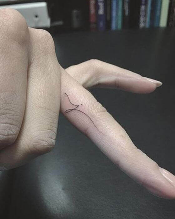 Initial Tattoo on finger