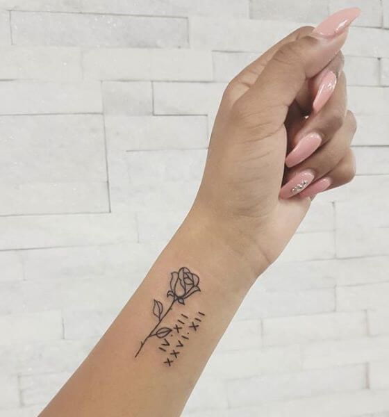 Rose with Roman Numerals Tattoo on wrist