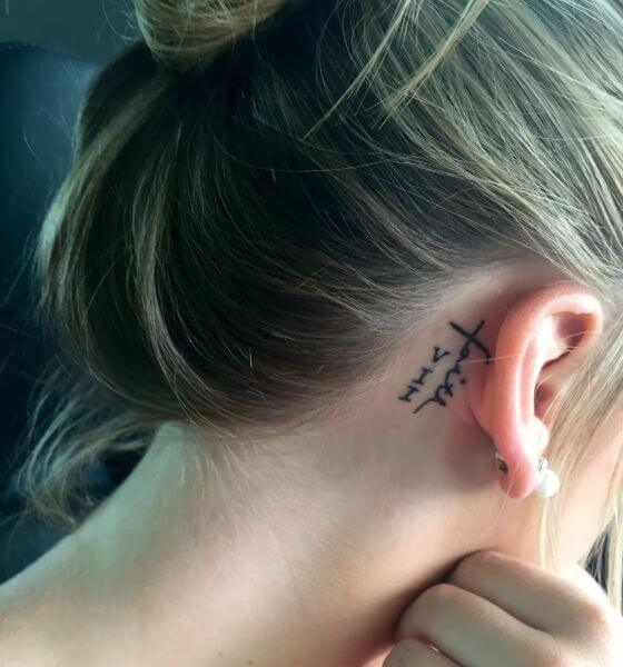 Best Roman Numerals Tattoo on behind the ear