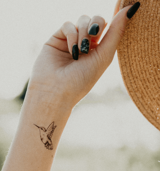 Small Hummingbird Tattoo on girl's wrist