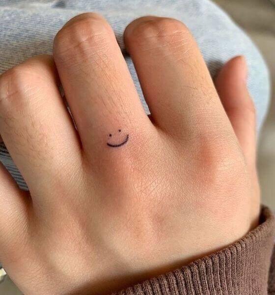 Happiness Finger Tattoo