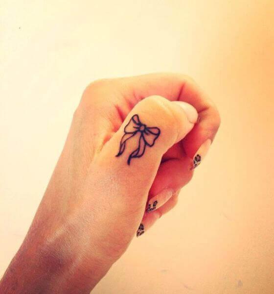Ribbon Finger Tattoo