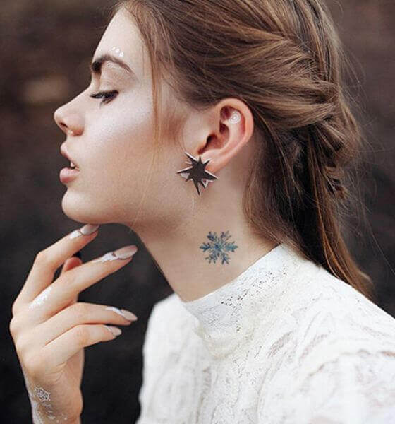 Beautiful small neck tattoo