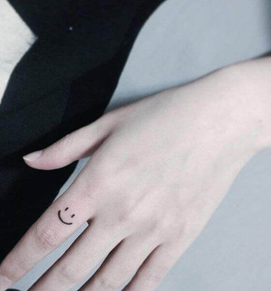 Smiley Face Finger Tattoo