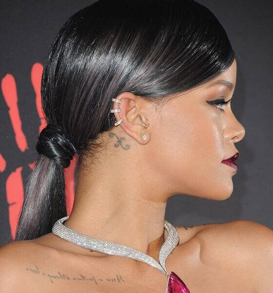 The pisces sign behind her ear - Rihanna tattoo