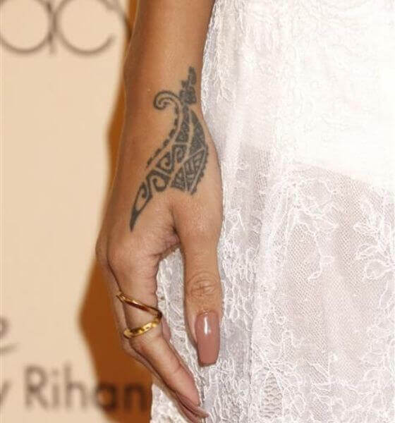 Tribal dragon claws on her hand | Rihanna's tattoo