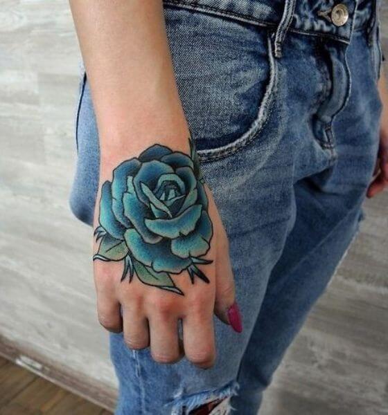 Amazing Blue rose tattoo on hand