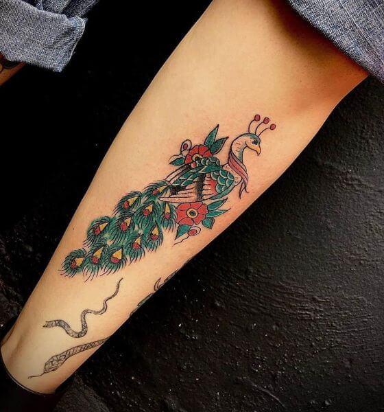 Beautiful Peacock Tattoo on Sleeve