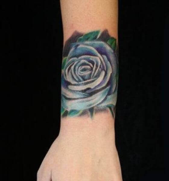 Blue rose tattoo on arm