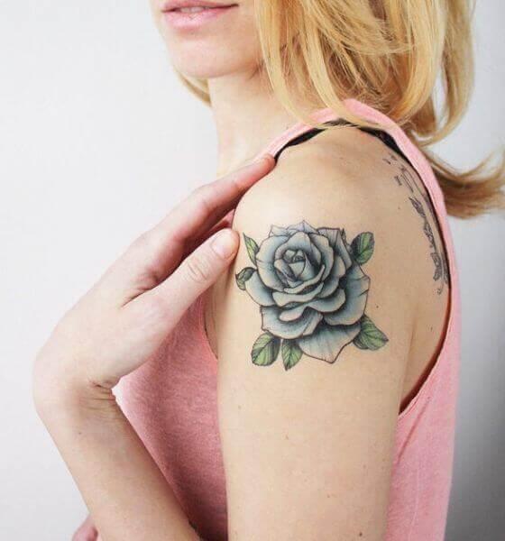 Blue rose tattoo on half sleeve