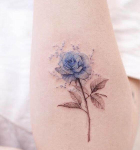 Blue rose tattoo on hand