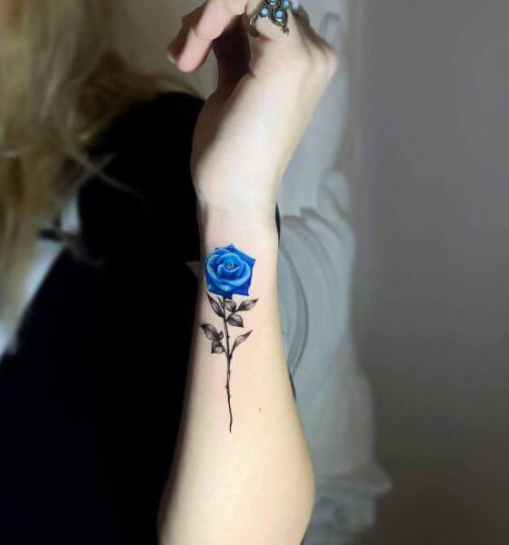 Blue rose tattoo on wrist
