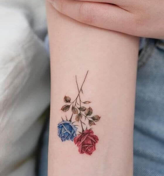 Two-color rose tattoos on hand