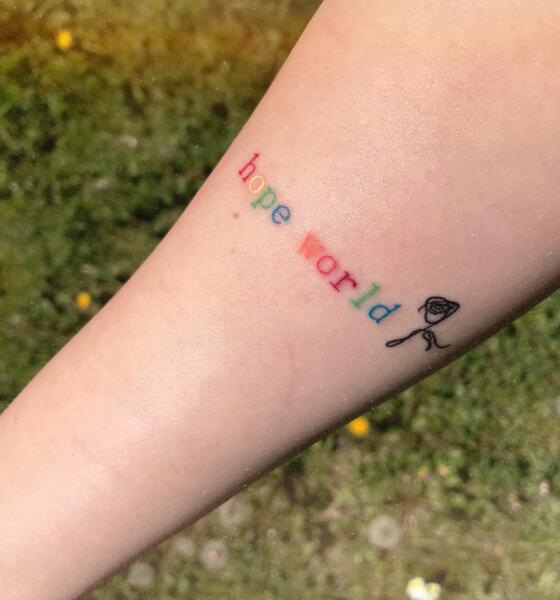 Hope tattoo on arm