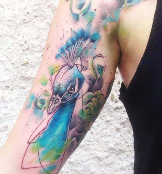 Pretty Peacock Face Tattoo
