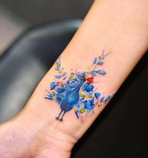 Stunning Peacock Tattoo on Wrist