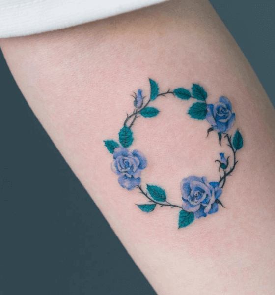 Roundy blue rose tattoo design