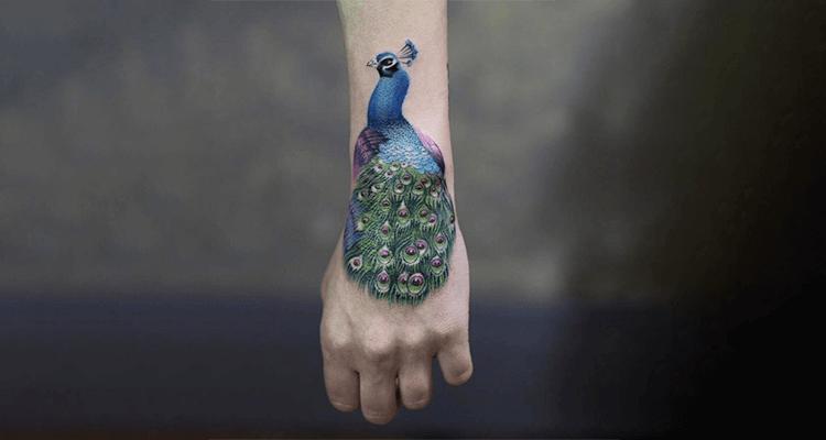 Stunning Peacock Tattoo Design on Hand
