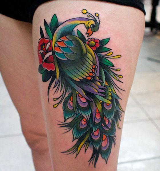 Swirls peacock tattoo on thigh
