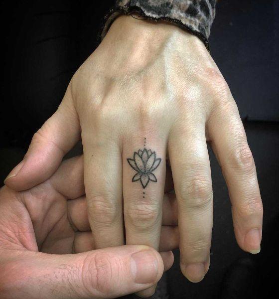 Tiny Lotus Flower on Finger