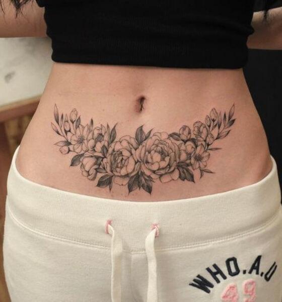 Pretty Flower Tattoo on Women's Stomach