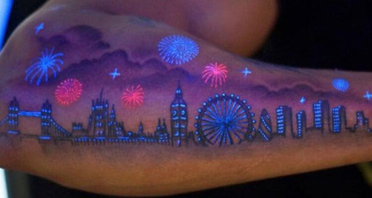 UV Tattoos on arm dark tattoo